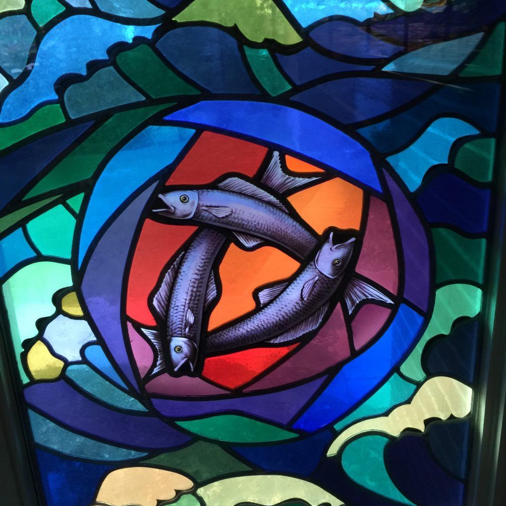 stained window image of 3 fishes