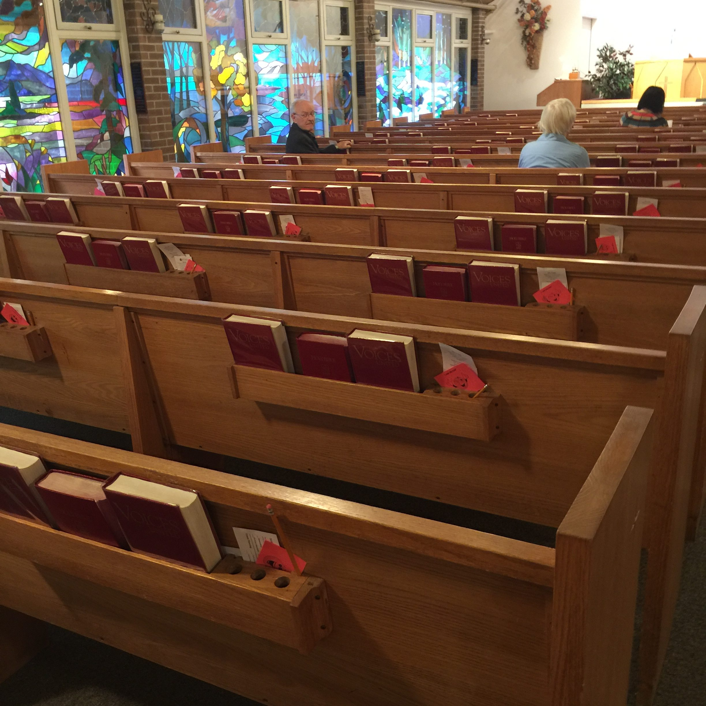 church pews and stained glass windows