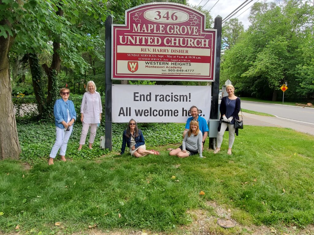 """Maple Grove United Church sign, with """"End Racism! All welcome here."""" added"""
