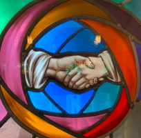 Stained window, hands shaking